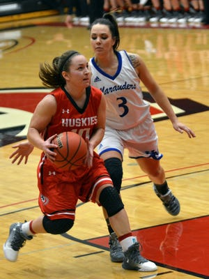 St. Cloud State's Andrea Thomas drives with the basketball as the University of Mary's Dani Williams tries to steal the ball Saturday at Halenbeck Hall. Mary beat the Huskies 82-81 in an NSIC women's basketball game.