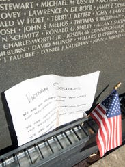 A note and an American flag are among the items left