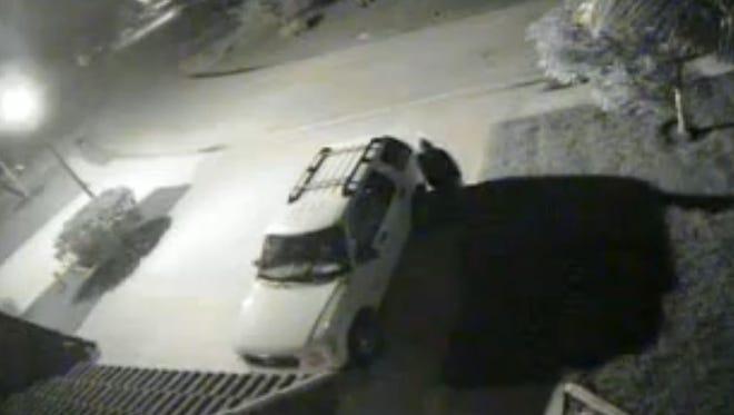 Burglary security camera still image.