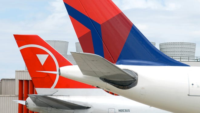 Delta and Northwest aircraft tails. The 2008 merger brought 747s back into Delta's fleet for the first time since the 1970s.