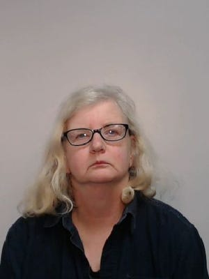 Barbara Coombes, of Stockport, England, was sentenced to nine years in prison for killing her father then hiding his death for 12 years. She struck her father with a shovel in 2006 then buried his body in his garden, police said.