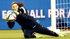 Hope Solo makes a save during training on Monday.