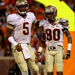Jameis Winston and Rashad Greene walk back to the FSU sidelines from the end zone during their game at Clemson on Oct. 19, 2013. The Seminoles beat the Tigers 51-14.