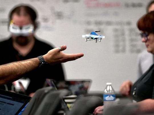 Joe Ferguson (left) pilots a first-person-view drone around the room during the 5th annual HACKmemphis Hackathon Sunday morning at the University of Memphis. The weekend-long hackathon event is a chance for technology buff of all types to come together to work on hardware and software projects that interest them.