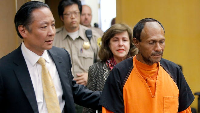 Juan Francisco Lopez-Sanchez, right, is led into a courtroom by San Francisco Public Defender Jeff Adachi and Assistant District Attorney Diana Garcia for his arraignment.