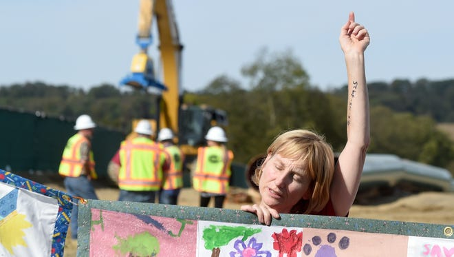 """""""The world is being held hostage by fossil fuel industries and we need to save ourselves,"""" said Ann Dixon, of Philadelphia. Dixon was one of the protesters arrested while protesting  construction of the Atlantic Sunrise Pipeline outside of Columbia, Pa. They were blocking the entrance to the construction site and were arrested by Pennsylvania State Police."""