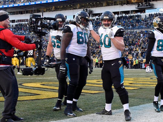 Jacksonville Jaguars fullback Tommy Bohanon (40) celebrates his touchdown during the second half of an NFL divisional football AFC playoff game against the Pittsburgh Steelers in Pittsburgh, Sunday, Jan. 14, 2018. (AP Photo/ Don Wright)