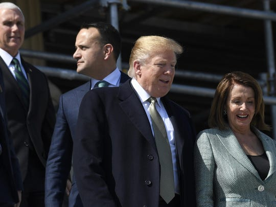 House Speaker Nancy Pelosi of Calif., right, talks with President Donald Trump, second from right, as Irish Prime Minister Leo Varadkar, second from left, and Vice President Mike Pence, left, follow as they walks down the steps of the Capitol in Washington, Thursday, March 14, 2019, following a lunch.
