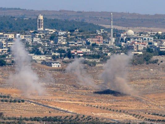 _media_USATODAY_None_2014_09_23_1411498855000-AP-Mideast-Israel-Syria (2).jpg