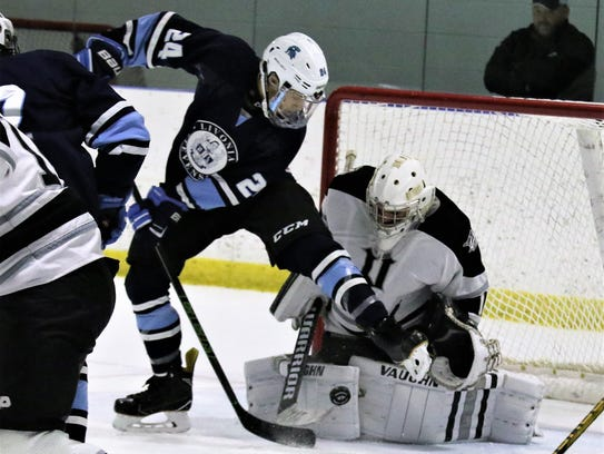 Plymouth goalie Brendan Olepa stops an in-close attempt