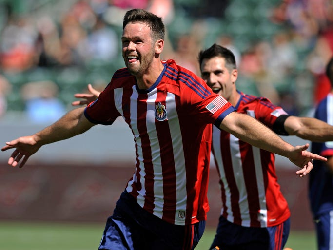 Chivas USA defender Bobby Burling celebrates his tiebreaking goal late in the second half against the Chicago Fire. Burling' tally gave Chivas a 3-2 win.