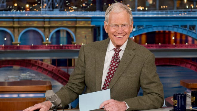 "David Letterman, host of the ""Late Show with David Letterman,"" smiles April 3, 2014."