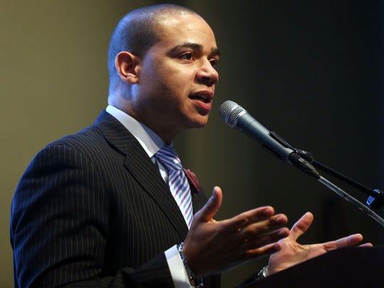 Keynote speaker Pastor John Faison speaks in 2015 at the Murfreesboro NAACP Dr. Martin Luther King Jr. Breakfast Celebration at MTSU.