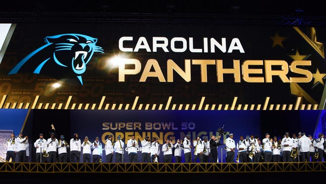 Members of the Carolina Panthers are introduced during Super Bowl 50 Opening Night media day at SAP Center.