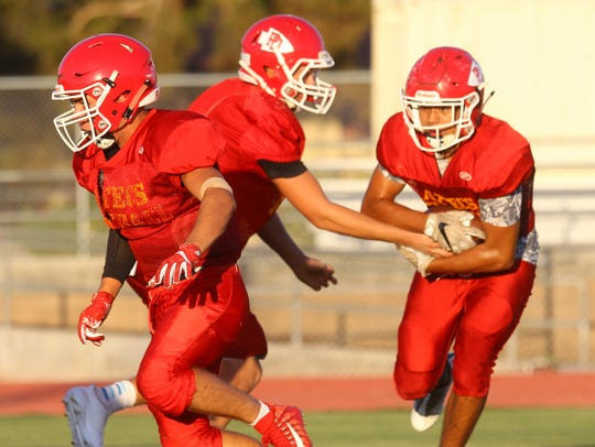 Palm Desert High School football players practice in