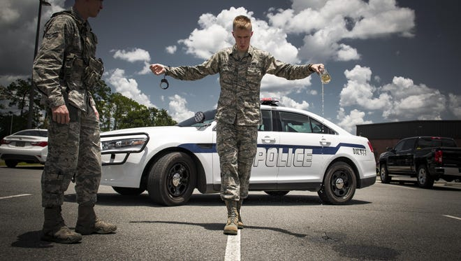 Airman 1st Class Erick Requadt, a 23rd Wing photojournalist, simulates a field sobriety test, July 7, 2017, at Moody Air Force Base, Ga. When an Airman receives a driving under the influence charge, they are eligible to receive both a civilian conviction if caught off base, as well as a punishment given at their commander's discretion. The final sentence could cost thousands of dollars in fines, suspension of their license, negative paperwork, administrative demotion and possible loss of career or reclassification.