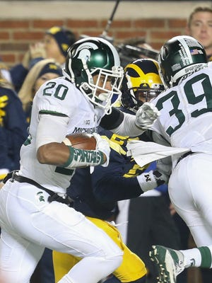 Michigan State's Jalen Watts-Jackson runs back a botched punt attempt by Michigan's Blake O'Neill for the game-winning touchdown in the final seconds of MSU's win on Oct. 17 in Ann Arbor.
