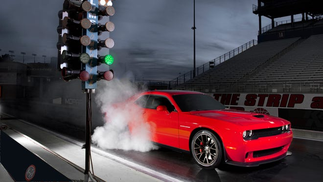An Illinois man was arrested in the early morning of April 7, 2017, after being pulled over for driving his 2016 Dodge Challenger Hellcat, similar to the 2015 model pictured, at nearly 160 mph on an Indiana Toll Road.
