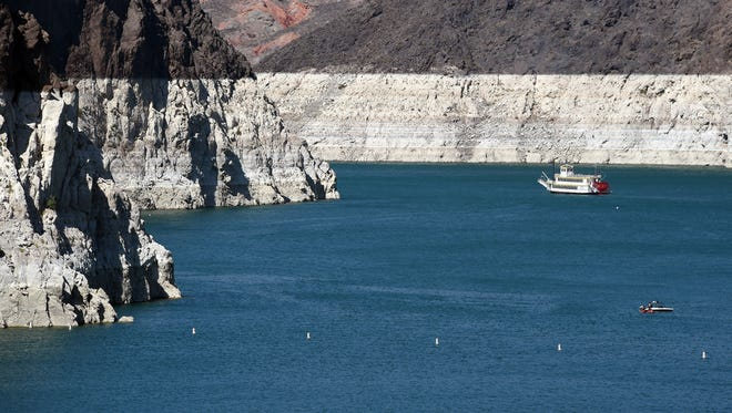 """Lake Mead is at its lowest level since the 1930s, leaving a white """"bathtub ring"""" of mineral deposits as high as 130 feet."""