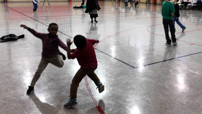 Kids enjoy after school free time in the gym at The Dream Center on West Morgan Avenue in Evansville Thursday, December 7, 2017.
