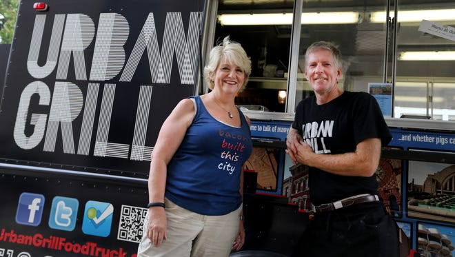 Betsy Eicher, left, with her brother-in-law Randy Reichelderfer at their Urban Grill food truck.