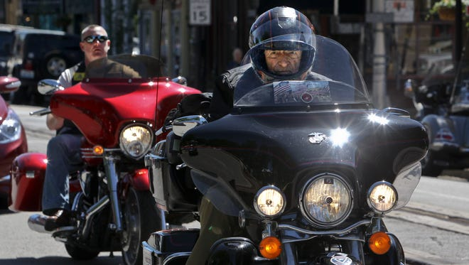 E. Bruce Heilman, of Richmond, Va., an 88-year-old Marine veteran, passes through La Grange Tuesday on his 6,000-mile motorcycle trip across America. His trip is part of a grass-roots campaign to raise awareness of World War II.