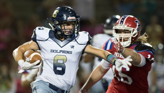 Jake Weldon (6) finds some open field during the Gulf Breeze vs Pace high school football game at Pace High School on Friday, October 13, 2017.