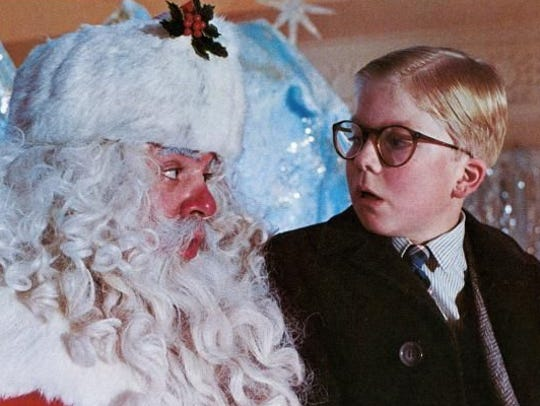"""Ralphie (Peter Billingsley) is stymied by Santa in a scene from """"A Christmas Story."""""""