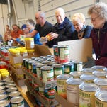 Four times a year, 15 to 30 seniors with the Retired Senior Volunteer Program help load boxes of food delivered to seniors across the region for the Commodity Food Program.