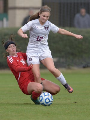 Alcoa junior Pelton Bledsoe trips up Signal Mountain sophomore Lucy Calhoun Frances Buntain as the Lady Tornadoes go on to beat the Lady Eagles 2-0 in the Class A state soccer championship Saturday at Richard Siegel Soccer Complex in Murfreesboro, Tenn.