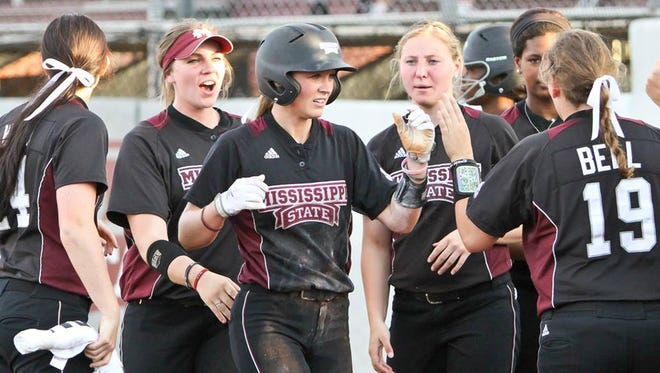 Mississippi State softball players celebrate scoring a run in their win over No. 1 LSU.