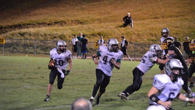 Lane Millsaps (10) carries the ball alongside Colby Hemphill (44) in Monday's game at Murphy.