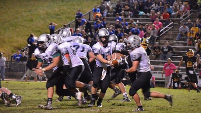 Robbinsville quarterback Colton Millsaps makes a handoff during a game earlier this season.