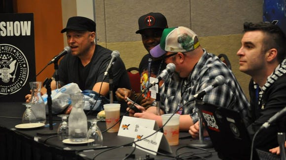 Leigh George Kade, left, speaks during a recording of 'Geekshow Podcast' with fellow panelists Jay Whittaker, Shannon Barnson and Jimmy Martin in 2014.