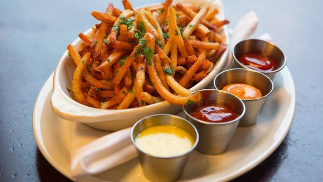 Duck frites at Django come with Béarnaise, harissa aioli and curry ketchup. Mental Floss called them the best french fries in Iowa.