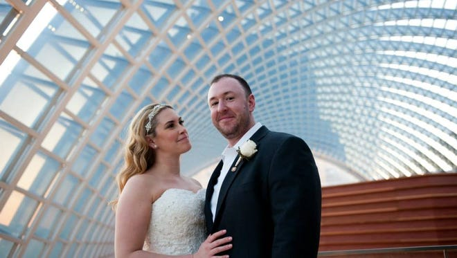Michelle and Aaron Harris were married at The Kimmel Center to celebrate their passion for the arts.