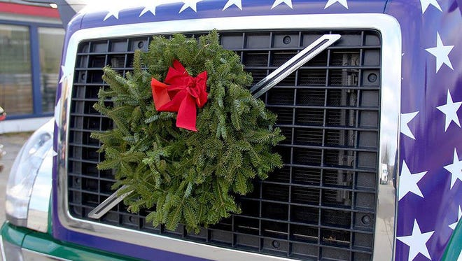 The second Saturday in December, a caravan of volunteers bearing handmade balsam wreaths leave Maine destined to place them with honor on fallen soldiers' graves at Arlington National Cemetery in Washington, D.C.