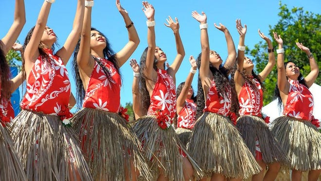 Chamorro dancers perform.