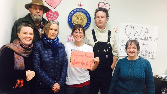 Ithaca Catholic Workers protested during a sit-in at Rep. Tom Reed's office in Ithaca.