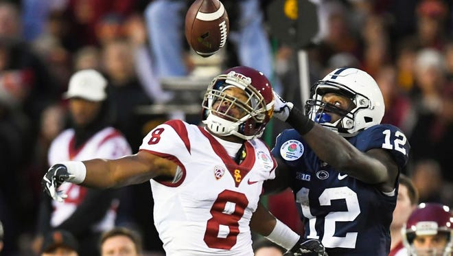 Chris Godwin (12) catches a pass over Southern Cal defender Iman Marshall in the Rose Bowl on Jan. 2. Godwin had nine receptions for 187 yards against the Trojans.