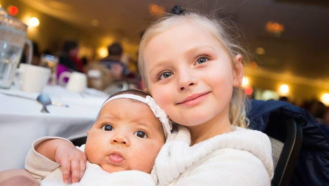 Harlow Pinto and Ariah Smith pose at Life Enforcement's Feed 100 Friends and Family Christmas Dinner.