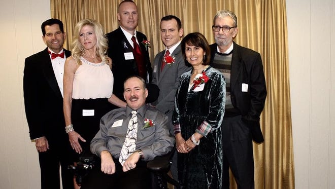 """Rich Myers (center in wheelchair) was among seven inductees into the Haddon Township High School Hall of Fame on Sunday at Auletto's. The Haddon Township man was selected under """"Community.""""  Other inductees pictured include: Mark Yellin (left to right), Kathy Mitchell Williams, Brett Young, Kevin Falkenstein, and Carol Testa and Rich Lamb (son and daughter of inductee Jim Lamb)."""