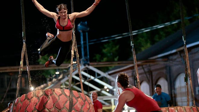 Chris Anne Myers takes a flying leap during competition in NBC's Spartan Ultimate Team Challenge, aired on Monday, June 26, 2017.