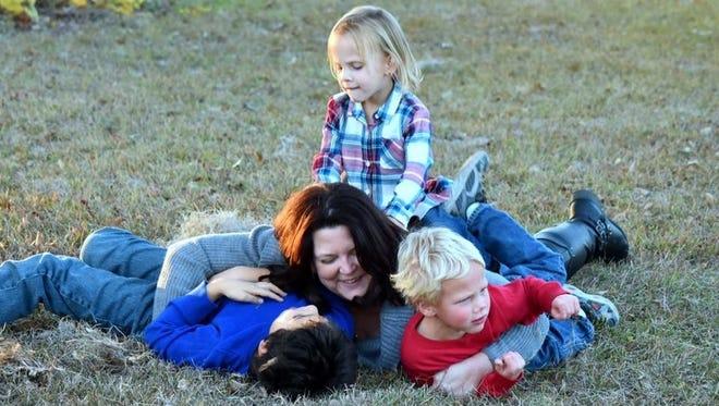 Heather Rosenberg and children.