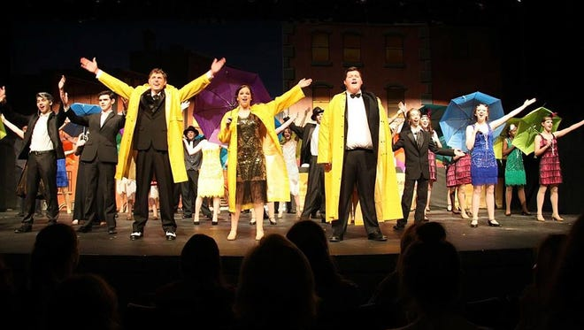 The cast for USJ's production of Singing in the Rain garnered the school's theater program honors during the Orpheum awards.