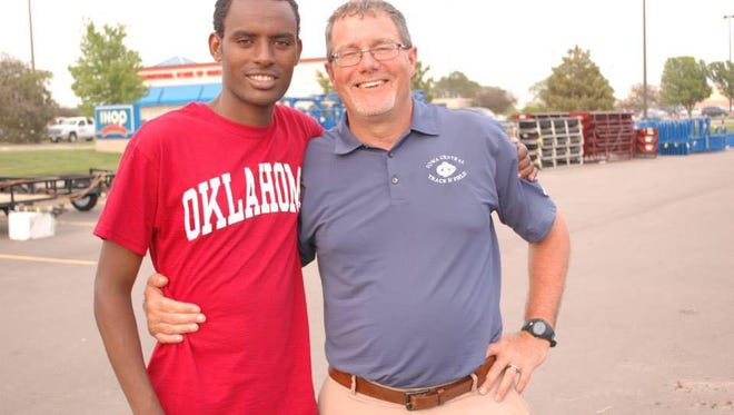 Biya Simbassa, left, and his coach at Iowa Central Community College, Denny Myers.