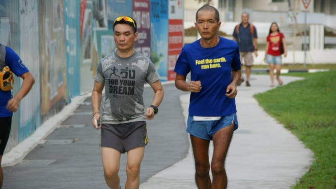 Japanese-born distance runner Atsuyuki Katsuyama (right), the owner of a vegan restaurant in Thailand, plans to retrace the footsteps of the 1928 International Trans-Continental Footrace, better known as the Bunion Derby.