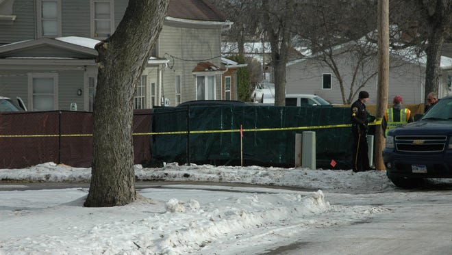 Police gather at a crime scene in Sisseton on Saturday, where a 22-year-old man shot four others before killing himself.