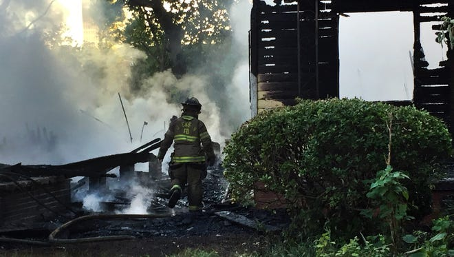 Three houses were destroyed by fire in downtown Jackson.