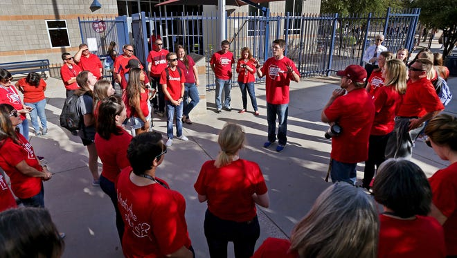 Teachers, staff and students at Cienega High School gather at the flagpole in unison to protest low pay and funding at the school, 12775 E. Mary Ann Cleveland Way, on April 11, 2018, in Tucson. Cienega participated with the state-wide walk-in protests before classes began.